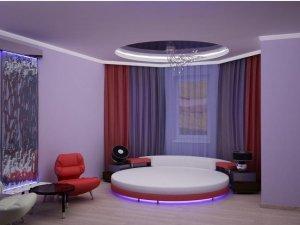 Круглая кровать в интерьере комнаты